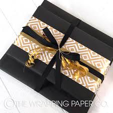 black gift wrapping paper roll wrapco eco matt black gift wrap decorated with a belli band in