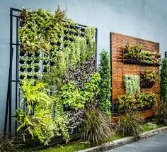 Self Watering Vertical Garden Vertical Gardens Are The Key To Self Sufficiency In The City