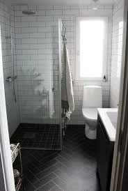 best ideas about small bathroom tiles pinterest bathrooms love everything about this bathroom the black herringbone floor white subway tiles