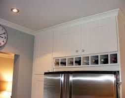 kitchen with wine racks over refrigerator ideas