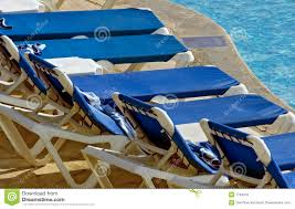 Pool Chairs Lounge Chairs Lined Up At Pool U0027s Edge Royalty Free Stock Photos