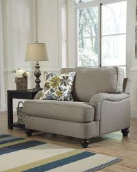 living room furnished with white end table and two oversized