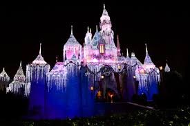 sleeping beauty castle disneyland during christmas at night