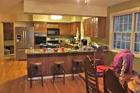 how to lighten wood kitchen cabinets painting kitchen cabinets and brick lighten up a kitchen