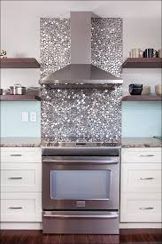 unique kitchen backsplash made from rounded glass tiles in modern