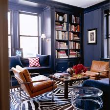 Zebra Side Table Warm Navy Walls And Woodwork Milo Chairs With Caramel Leather