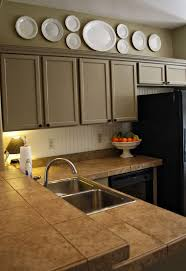 tile countertops decorating ideas for above kitchen cabinets