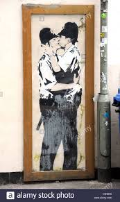 banksy wall stock photos banksy wall stock images alamy banksy graffiti on the wall of the prince albert pub in brighton the kissing policemen