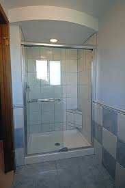 small bathroom with glass shower enclosure plus delectable blue