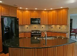 Kitchen Cherry Cabinets by Kitchen Backsplash Cherry Cabinets Black Counter Kitchen Crafters