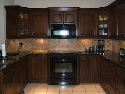 backsplash tile ideas for small kitchens traditional dark wood kitchen design with glass cabinetry