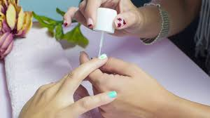 women are embellishing their manicures with yes you read