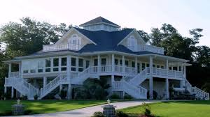 perfect craftsman style home with a wrap around porch country
