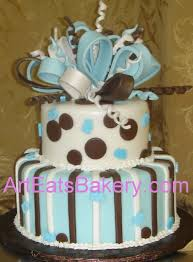 two tier brown and blue polka dot and stripe baby shower cake