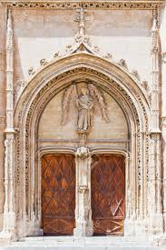 entrance of a historical church with ornaments and wooden