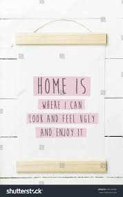 Home Is Quotes by Scandinavian Hipster Interior Design Wooden Frame Stock Photo