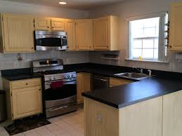 granite countertop cleaning varnished kitchen cabinets granite