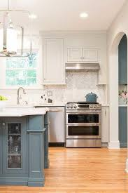 white kitchen cabinets with blue island blue gray island with white cabinets transitional kitchen