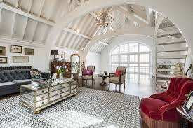 reception room sits beneath a large vaulted ceiling in this home