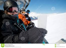 winter sport friends in chair lift with ticket stock photo image