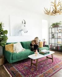 emerald green sofa rustic chandelier apartment inspo