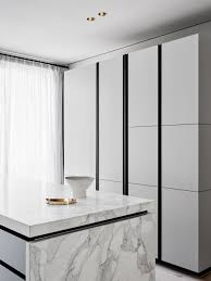 black and white sleek modern kitchen black faucet marble counter