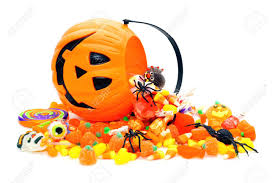 halloween candy spilling from a jack o lantern holder stock photo