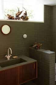 bathroom of the week two bath remodels with bold green tile in