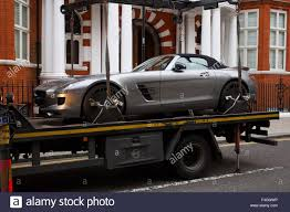lifted mercedes an illegally parked mercedes sls amg roadster is lifted from a