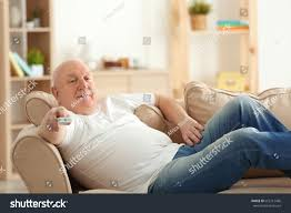 Couch Potato Tv Fat Senior Man Watching Tv While Stock Photo 663112486 Shutterstock