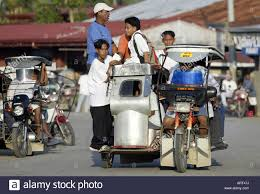 philippines taxi filipinos ride a tricycle taxi through the streets of mansalay