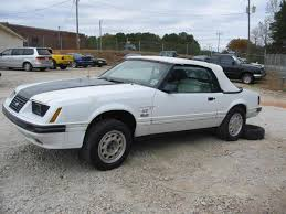 white ford mustang convertible