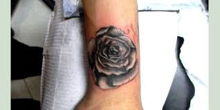 glorious rose tattoo on wrist photos pictures and sketches