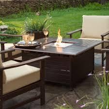 convenient propane outdoor fireplace in summer evenings
