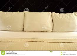 three pillows on a bed stock photos image 3875983