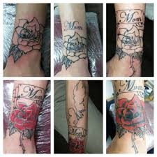 cover up of chinese writing with red rose tattoos by me
