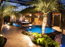 swimming pool and spa with outdoor kitchen bar and waterfalls