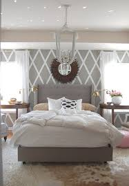 diamond stenciled wall fluffy layered rugs grey tufted bed cool