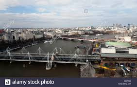 hungerford bridge the hungerford bridge on the thames with a row of 23 london buses on