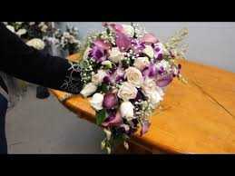 bridal bouquet holder table clip how to make a cascading bridal bouquet with roses orchids and calla