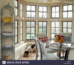 Country Dining Rooms by Narrow Metal Shelving Beside Large Bay Window In Country Dining