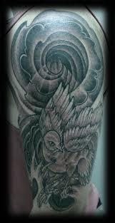 black n white half sleeve japanese tattoo design photos