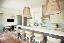 long gray kitchen island with basket chandeliers transitional