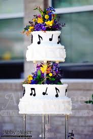 picture of music themed wedding cake with music notes as