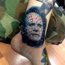 amazing pinhead portrait tattoo on ankle