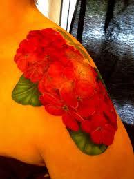 red ink geranium flowers tattoo on left shoulder