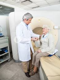 Doctor Comforting Patient Mature Male Doctor Comforting Senior Female Patient Before Ct Scan