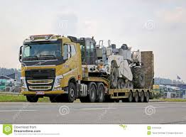 volvo heavy truck yellow volvo fh hauls heavy machinery editorial stock image