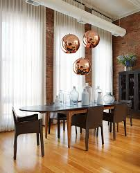 50 bold and inventive dining rooms with brick walls copper pendant lights from tom dixon make a big visual statement in this dining room