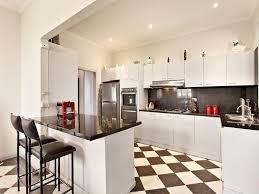 delighful modern galley kitchen design using floorboards photo in